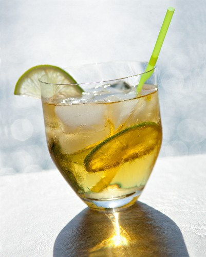 A cocktail made with rum, lime and ice cubes