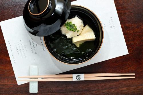 Kaiseki menu: scallop dumplings, bamboo, wakame algae and sancho pepper leaves