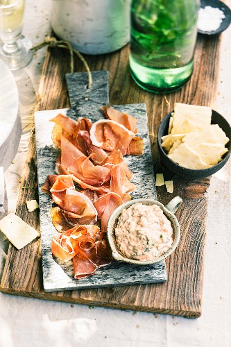 Ham antipasti with a pesto and cream cheese dip and crackers