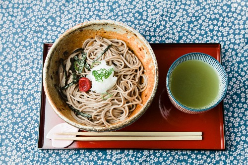 Soba noodles and green tea on an oriental serving platter (Japan)