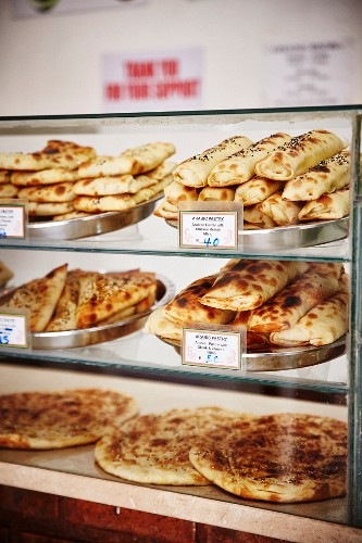 Arabic pastries and unleavened bread in a display case