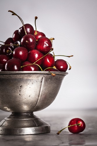 Fresh cherries in a metal bowl