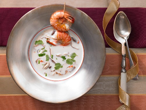 Coconut and lemongrass soup with a prawn skewer