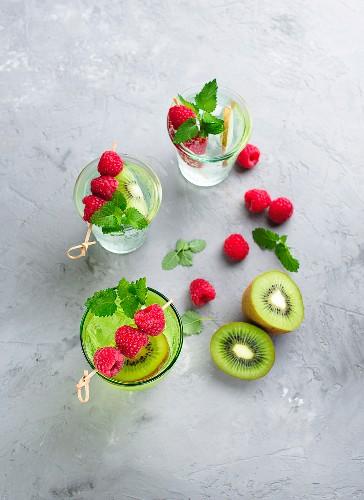 Ice cold summer lemonade with raspberries and kiwi