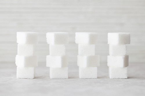 Several stacks of sugar cubes