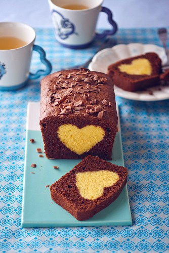 A sliced chocolate loaf cake with a heart made from plain cake mix