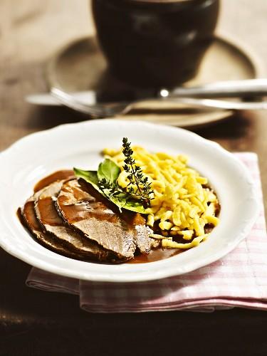 Sauerbraten (marinated pot roast) with home-made Spätzle (soft egg noodles) from Munich