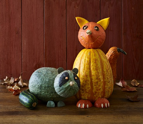Pumpkin decorations for Halloween: a fox and a raccoon