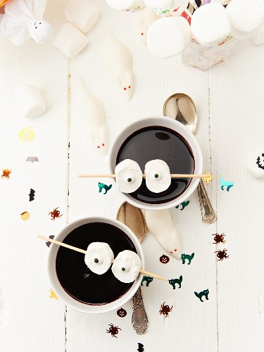 Elderberry soup decorated with marshmallow eyes