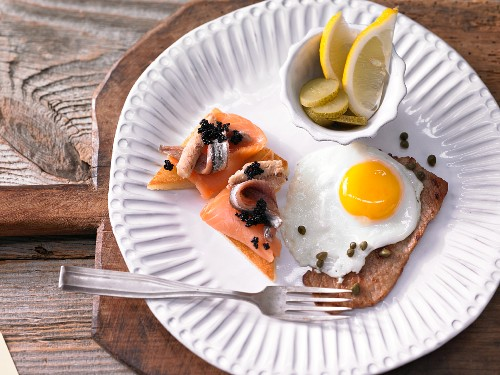 Holsteiner Schnitzel (escaloppe topped with a fried egg) and caviar