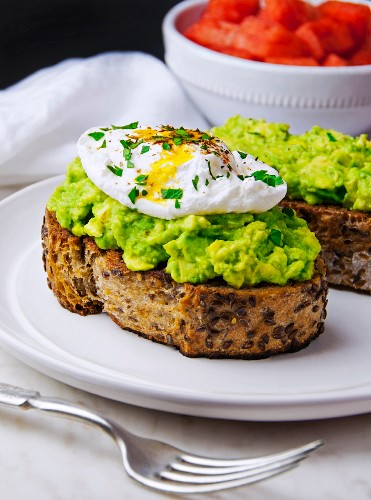 Toasted multi-grain bread topped with avocado purée and a poached egg