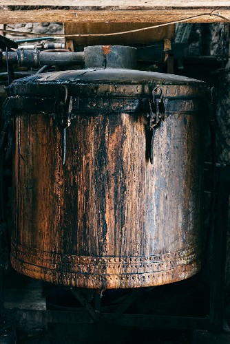 An old copper tank in the distillery for making pastis in Forcalquier, France