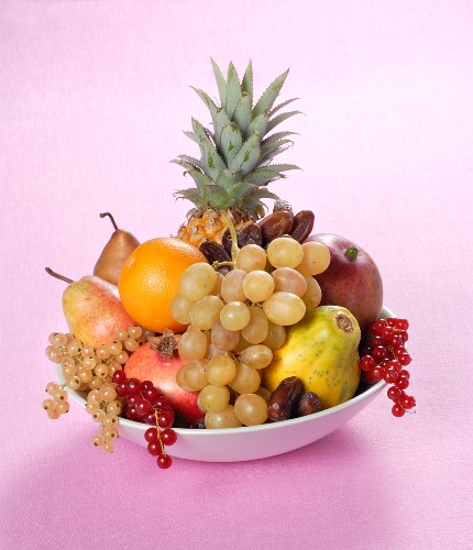 A fruit arrangement with pineapple and dates
