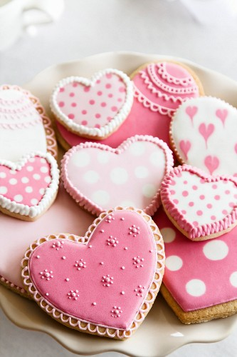 Heart shaped cookies with pink and white icing
