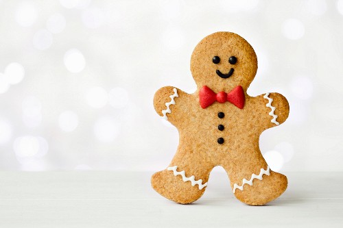 Gingerbread man with red bow tie