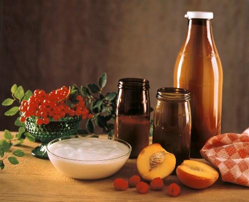 Bowl of Plain Yogurt; Bottles of Milk; Fresh Fruit