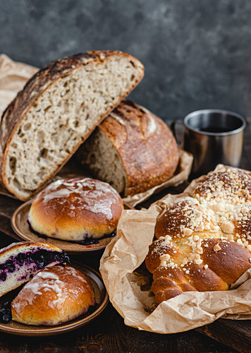 Sour dough bread, plaited loaves and blueberry rolls