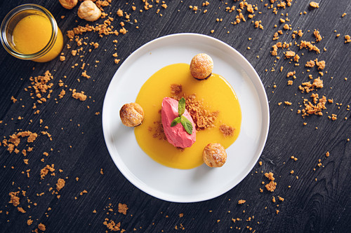 Raspberry ice cream with curable oranges chocolate and puff pastry