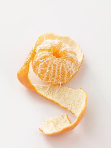 A half-peeled mandarin