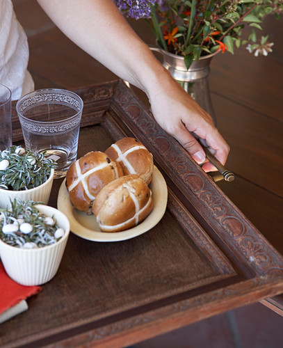 Hot cross buns and Easter decorations on DIY tray made from old wooden frame