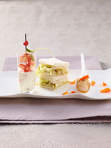 Wasabi swordfish sandwiches, scallops in carrot and passion fruit sauce, and shrimp in aloe vera lime cream