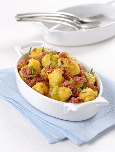 Polenta gnocchi with cotechino and savoy cabbage