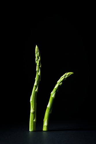 Spears of green asparagus standing up