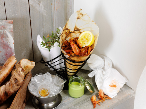 Grilled shrimps in a paper cone