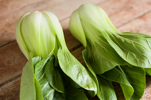 Pak choi on a wooden table