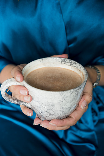 Hands holding a mug of hot chocolate