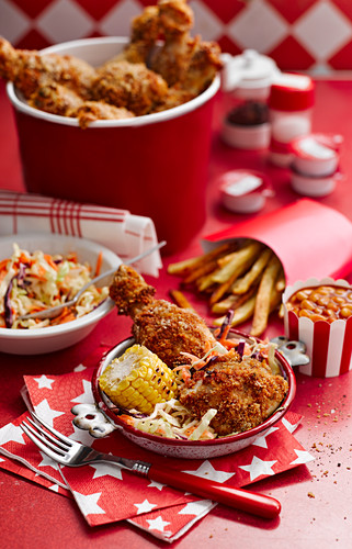 Baked chicken with corn, lettuce and french fries