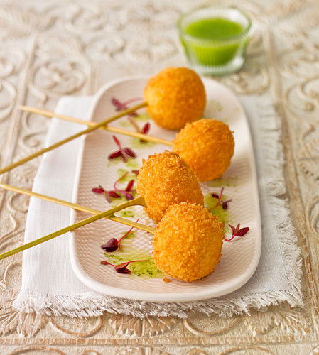 Fish ball aperitif, with a pea and mint dip