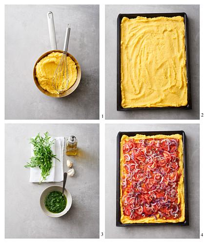 Vegan polenta pizza with tomatoes, onions and pesto