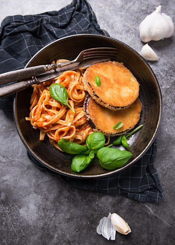 Aubergine cutlets with ribbon noodles in tomato sauce
