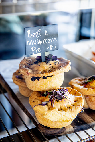 Small beef pies with mushrooms on a restaurant counter