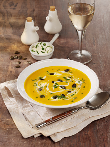Butternut squash soup with apple and processed cheese
