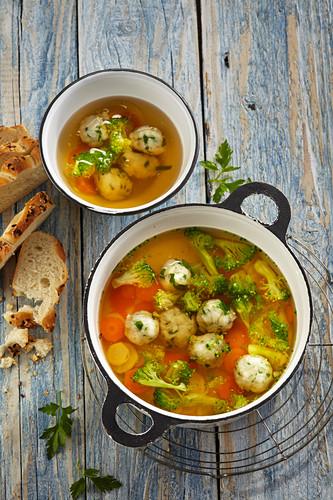 Vegetable soup with herb dumplings