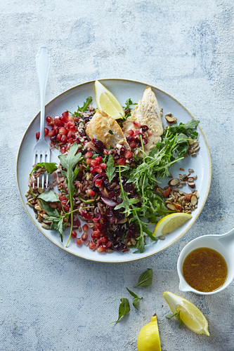 Warm salad with chicken, rice and cranberries