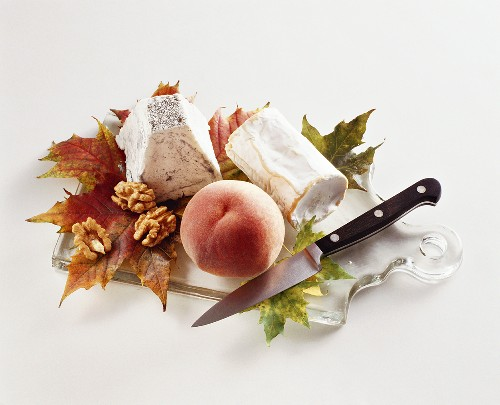 Two different goat's cheeses, one peach and walnuts