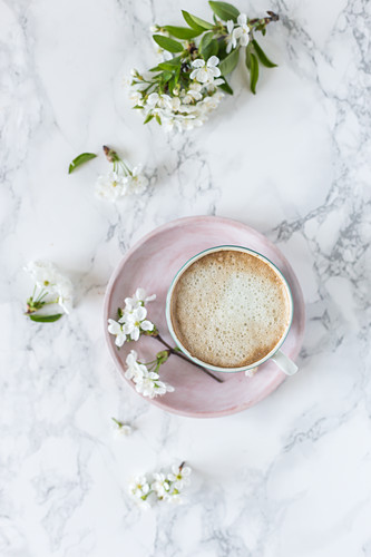 Cup of coffee and cherry blossom