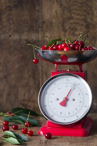 Fresh cherries on a vintage kitchen scale