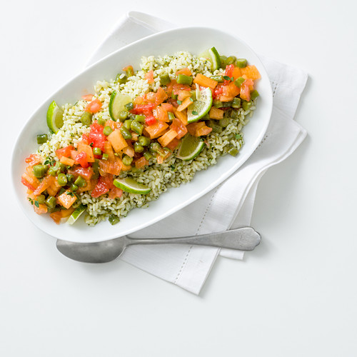 Rice with green pesto, tomatoes, watermelon and honeydew melon