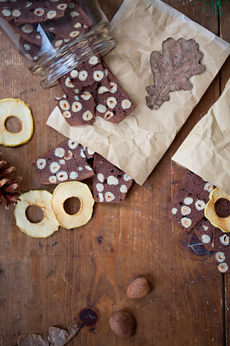 Dried apple rings and hazelnut biscuits on wooden table