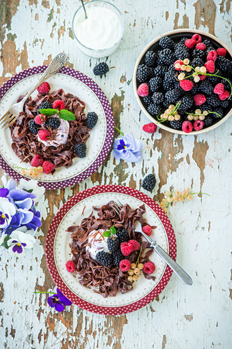 Chocolate noodles with fresh berries