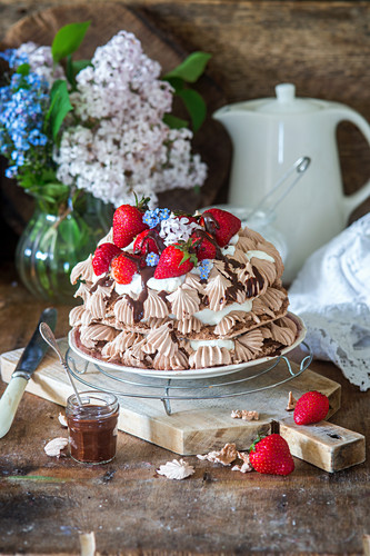 Chocolate meringue cake with fresh strawberries
