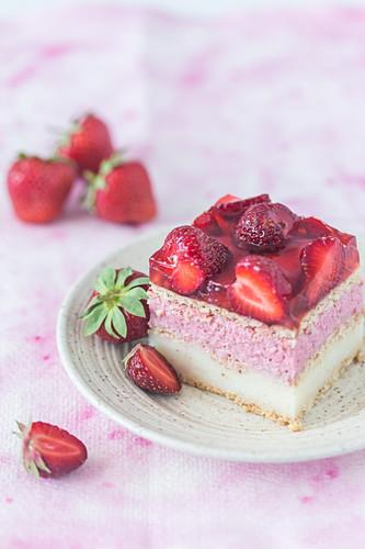 A slice of strawberry vanilla cream fridge cake