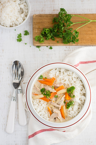 Rice with chicken sauce with vegetables and chicken