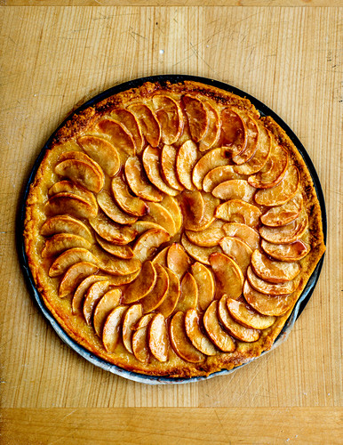 Apple tart on a wooden table (seen from above)