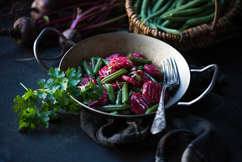 Beetroot gnocchi with green beans