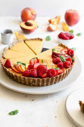 Vegan peach tart with a gluten-free base